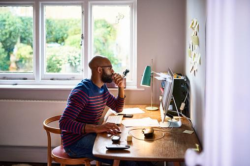 Photo of man sitting at computer