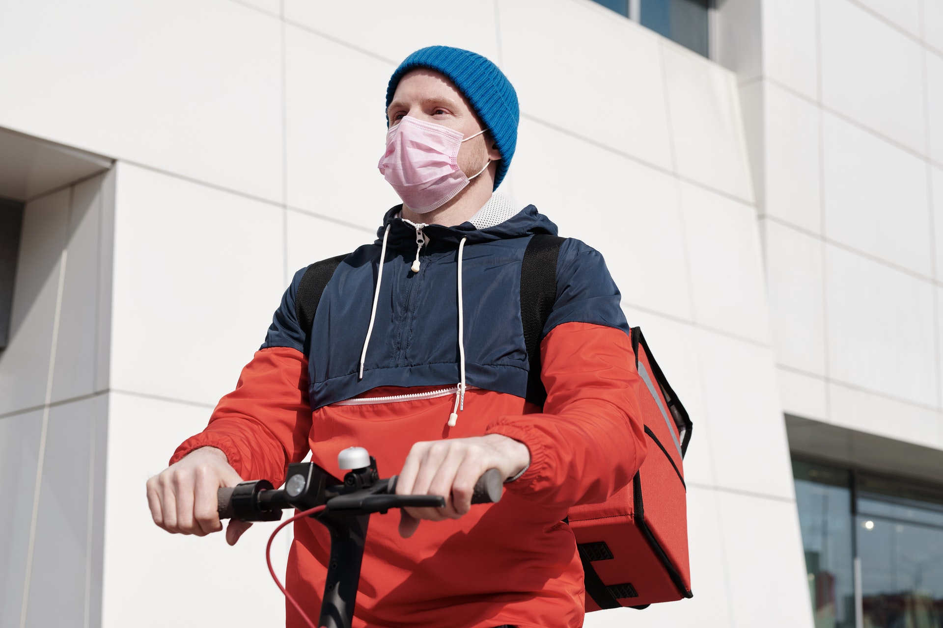man on bicyle wearing a mask