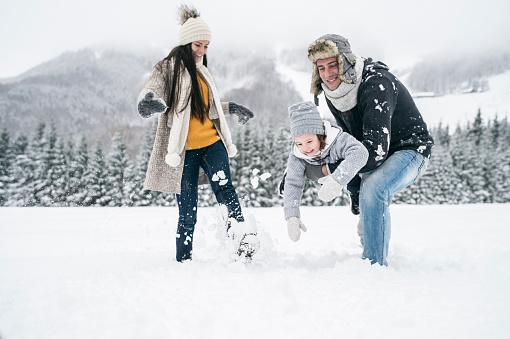 Family playing in snow