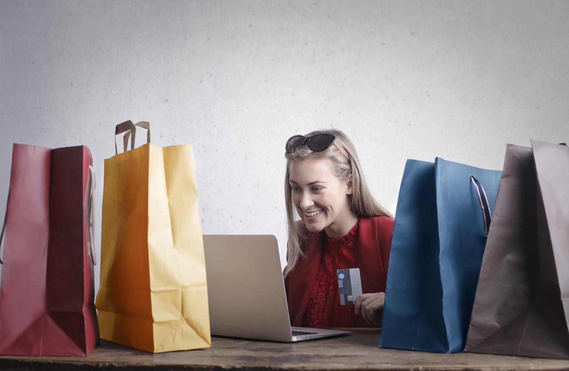 happy woman shopping online at home
